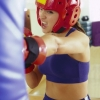 woman excersizing kick punch boxer gym training fitness