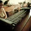 woman working in cigar factory line-up assembly line handmade cigars puros