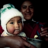 baby getting fed in huaraz peru andes indigenous family mom
